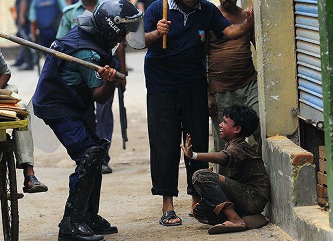 Police beating Christian Child