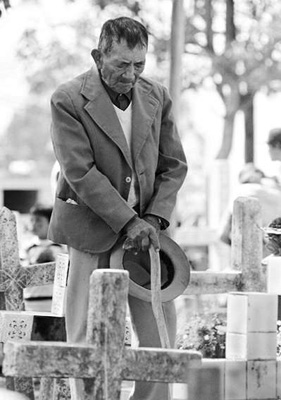 elderly man before grave
