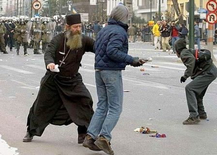 Priest trying to stop youth from throwing Molotov cocktail