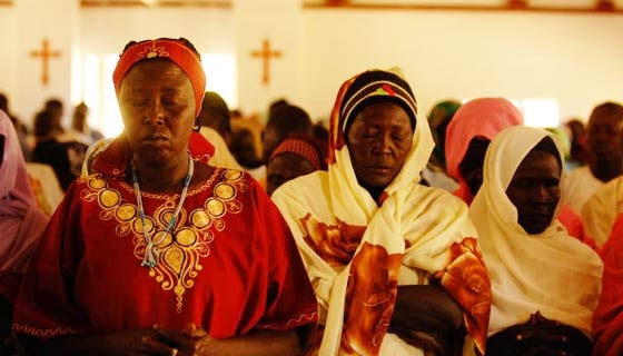 Sudanese Christian women praying