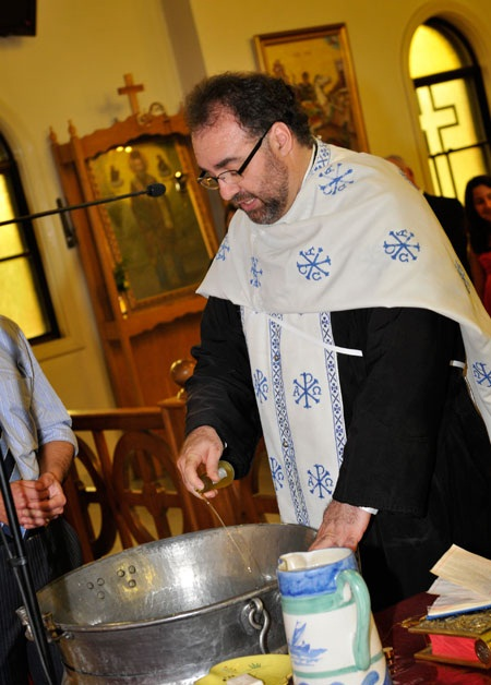 Fr Lysimachos (Leslie) Kostoglou blessing and anointing baptismal water