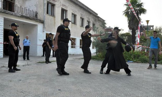 Christian priest in Premeti protests
