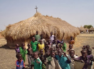 African hut church and community