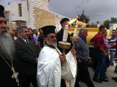 Fr. Daoud Philip Khoury receiving Holy Fire in Taybeh