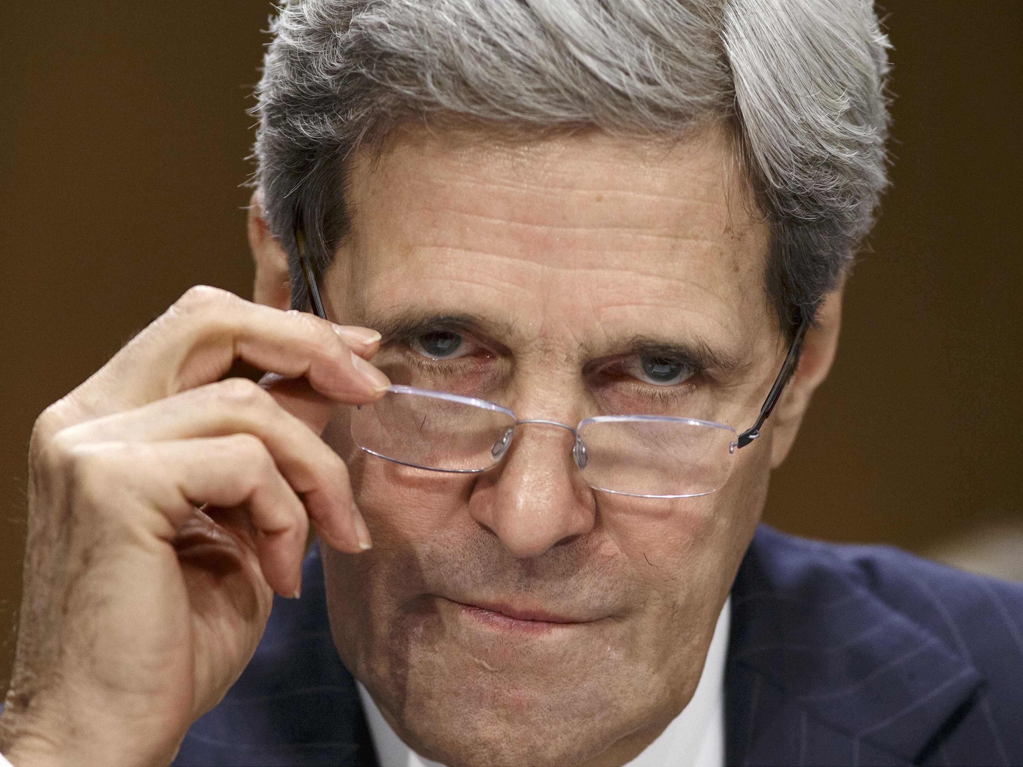 John Kerry blustering and warning Russia