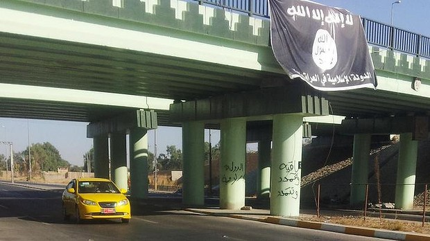 ISIS flag flies over entrance into Mosul
