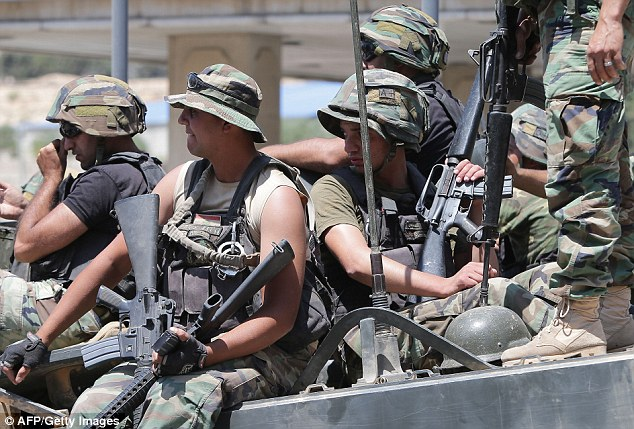 Members of the Lebanese army patrol near Arsal earlier this week
