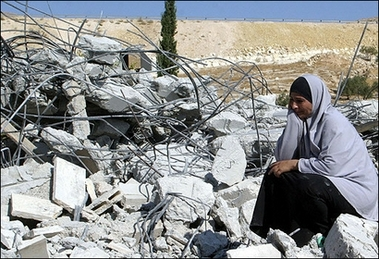 Palestinian woman weeping over destroye home