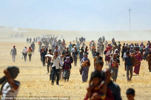 Thousands of Yezidis are trapped in the Sinjar mountains as they try to escape from ISIS forces