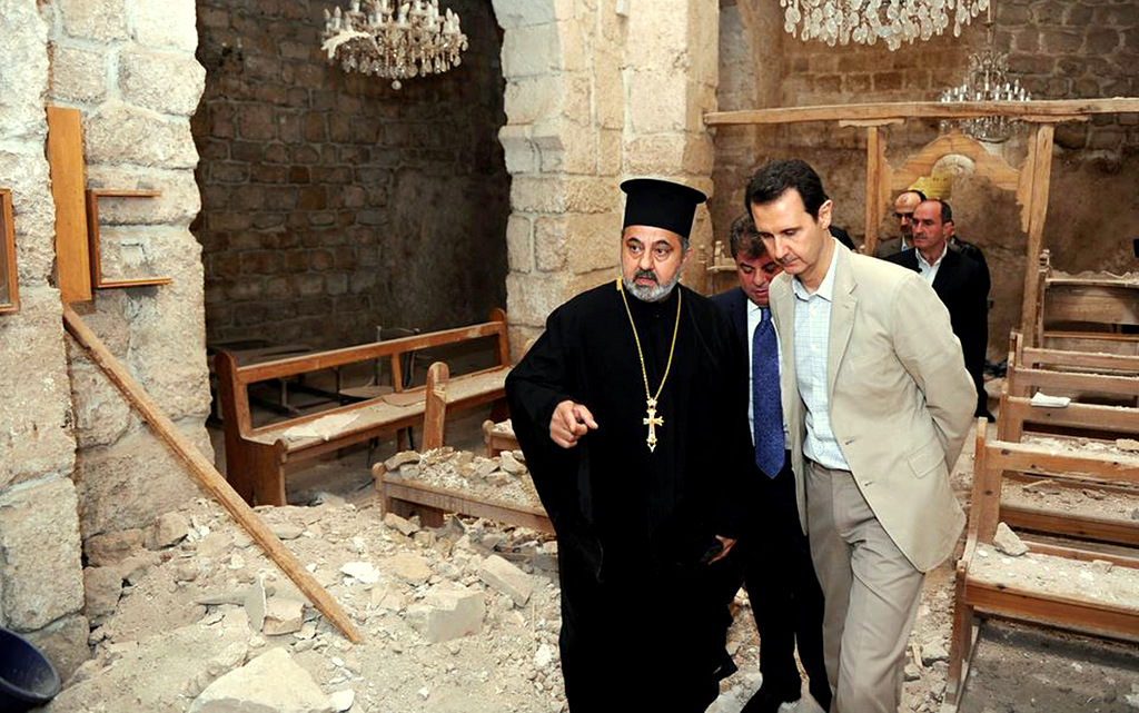 President Assad reviews damage of ancient church in Maaloula